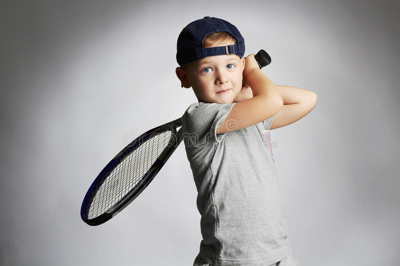 Little Boy Playing Tennis. Sport kids.Child with Tennis Racket royalty free stock photo