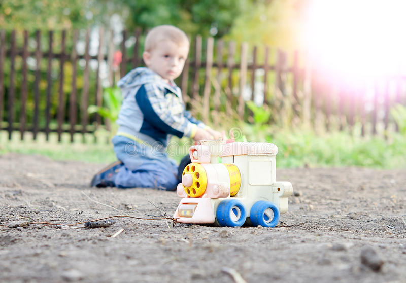 A little boy playing stock images