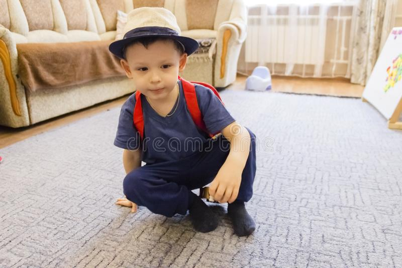 Little boy is playing on a toy guitar. Talented boy future musician stock photos