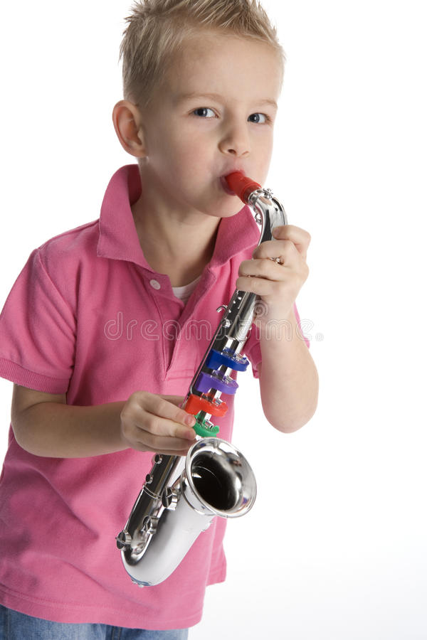 Little Boy Playing Toy Saxophone Royalty Free Stock Photos