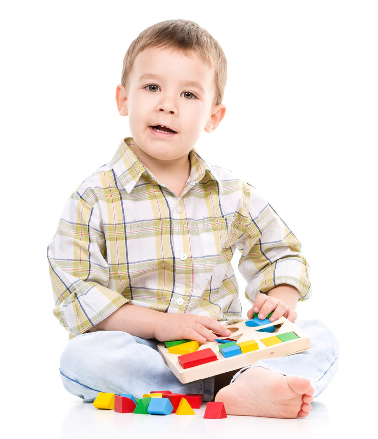 Little Boy Toys : Little boy is playing with toys stock photo image