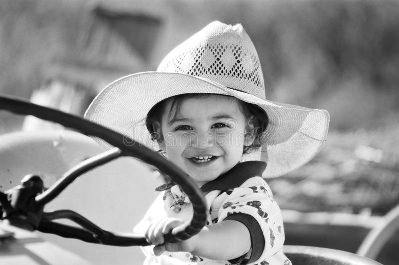Little boy playing on tractor stock photos