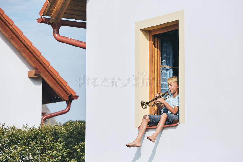 Little boy playing the trumpet royalty free stock images