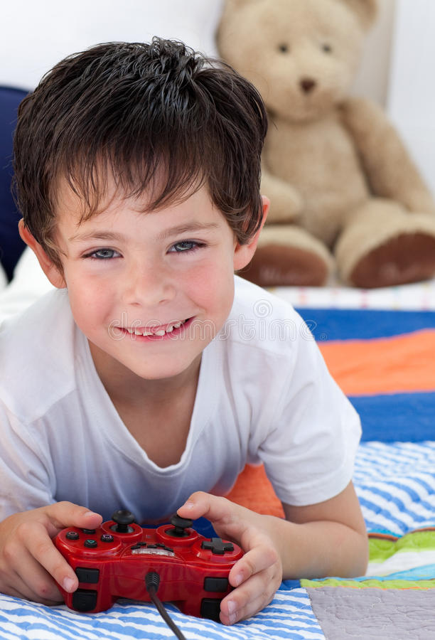 Little Boy Playing Video Games Stock Photography