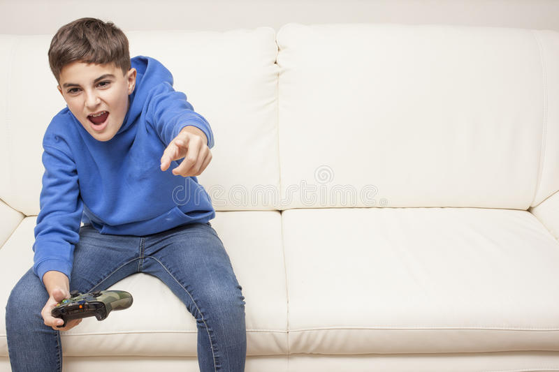 Little boy playing videogame royalty free stock photos