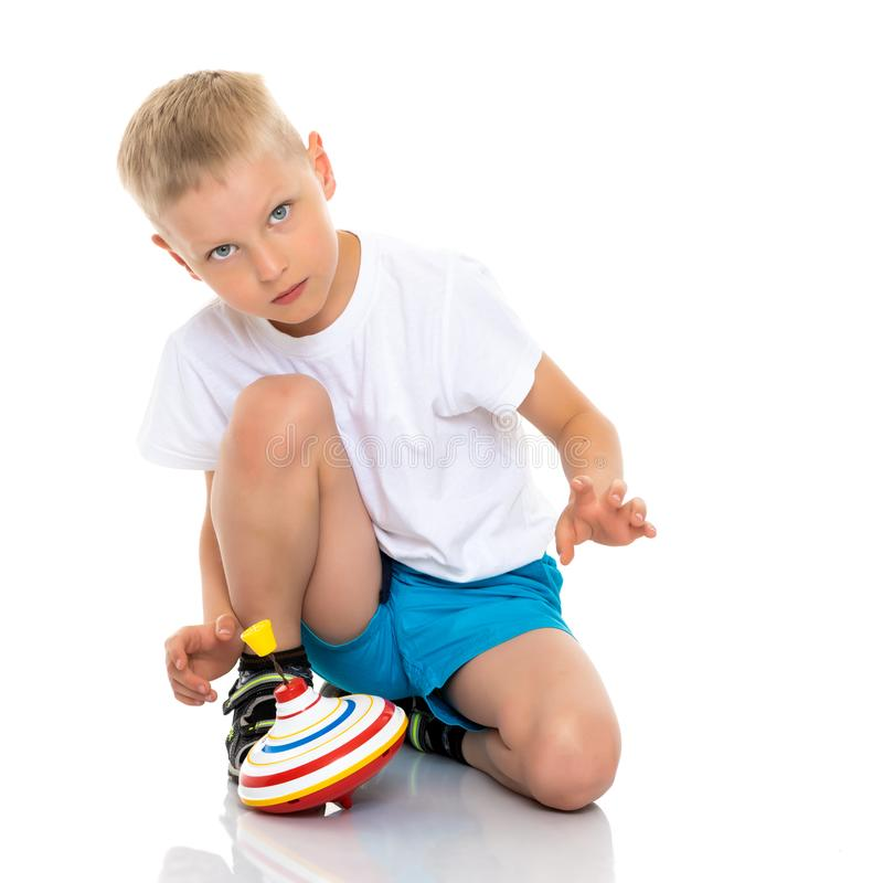 Little boy playing with a whirligig. royalty free stock photography