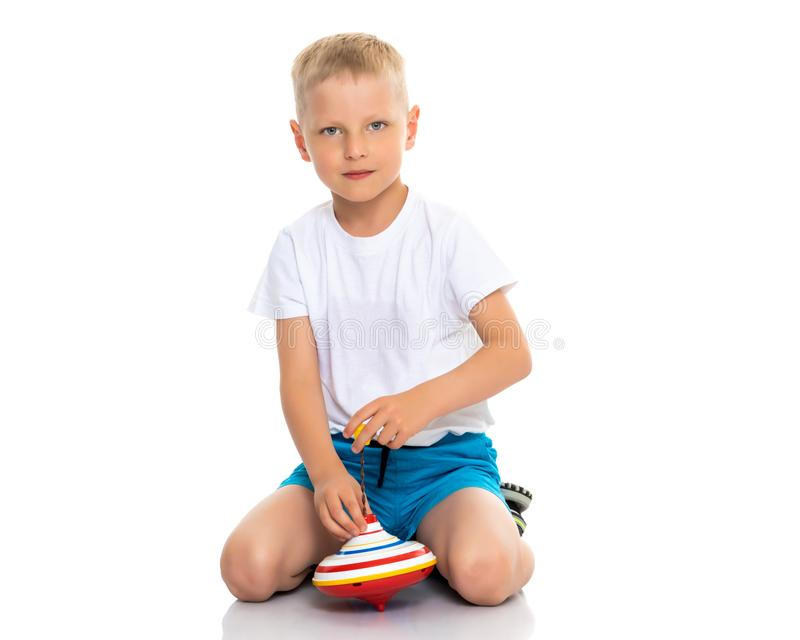 Little boy playing with a whirligig. stock image