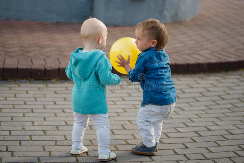 Little boy playing with yellow ball royalty free stock photo