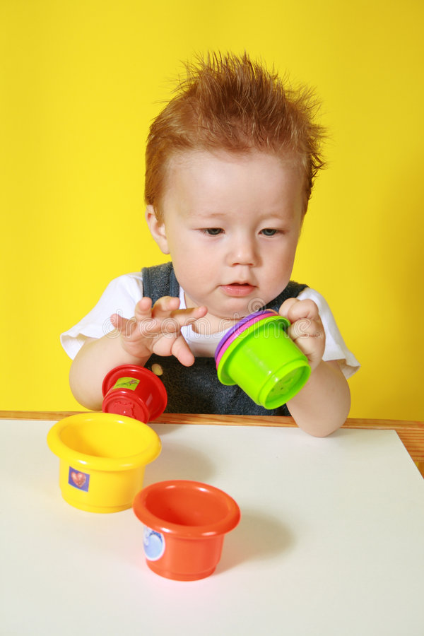 Little boy plays stock photo