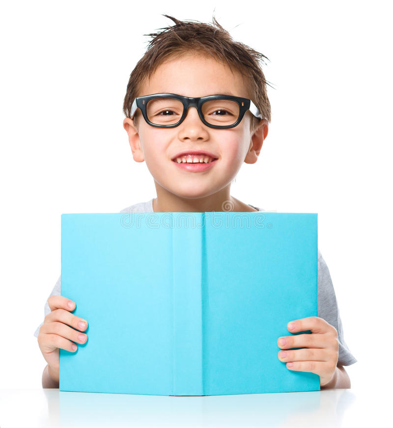 Little boy plays with book stock photo