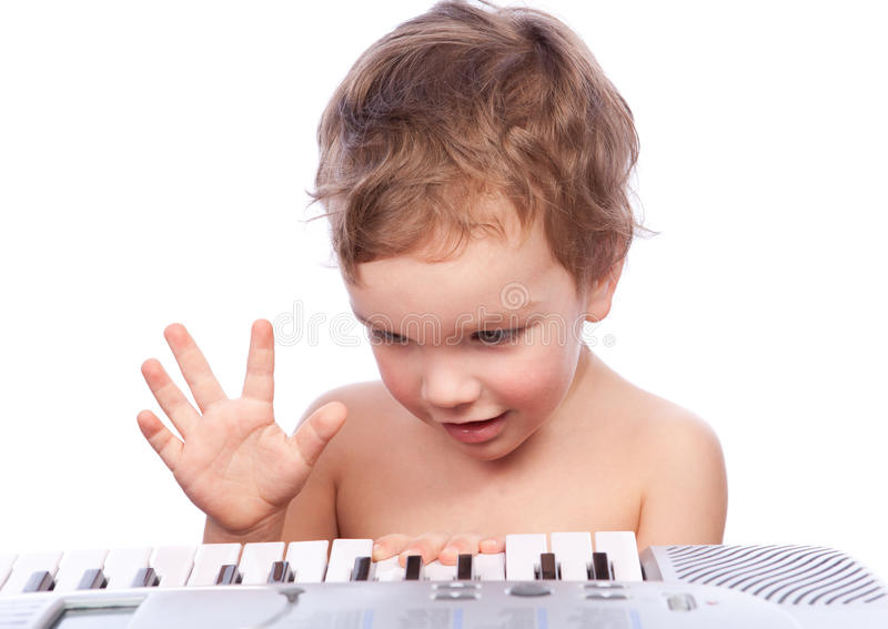 Download Little boy plays piano stock photo. Image of piano, face - 18768980