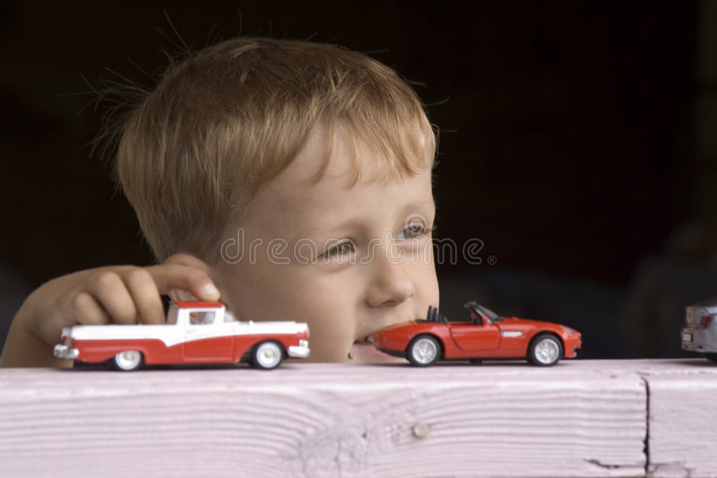 Little boy plays a toy car stock photos