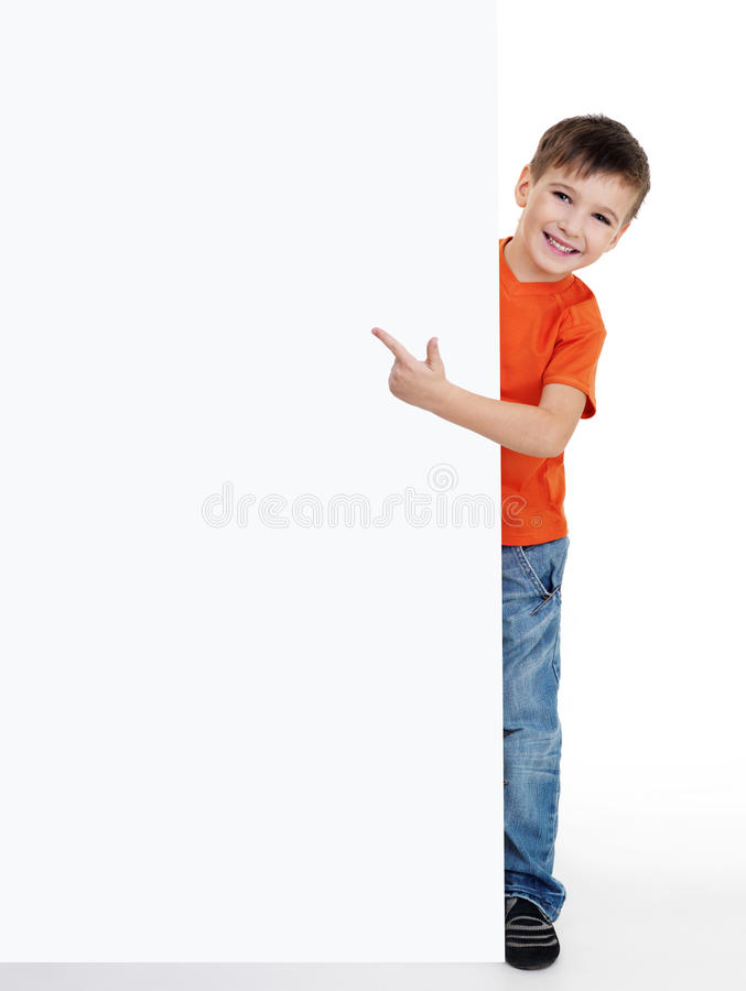 Download Little Boy Pointing On The Blank Poster Stock Photo - Image: 12029224