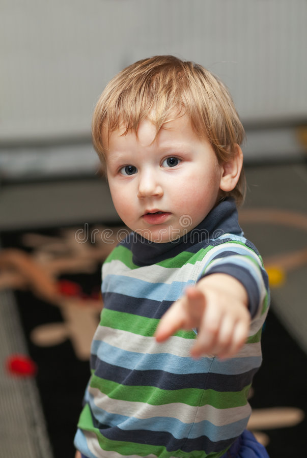 Little boy pointing at camera royalty free stock images