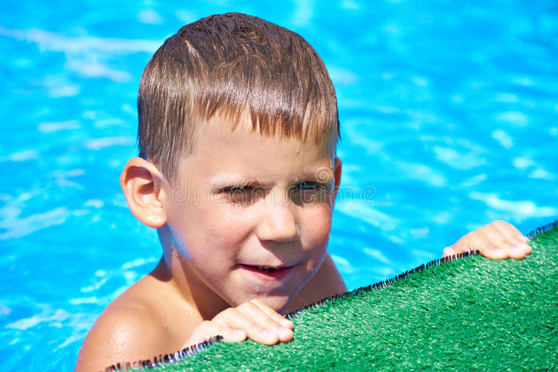 Little boy in pool. Little boy in the pool royalty free stock photos