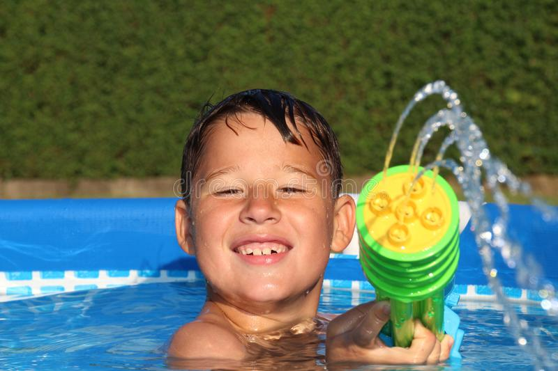 Little boy in a pool stock image