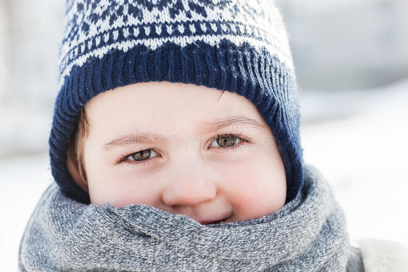 Little boy portrait in winter. Happy child stock photo