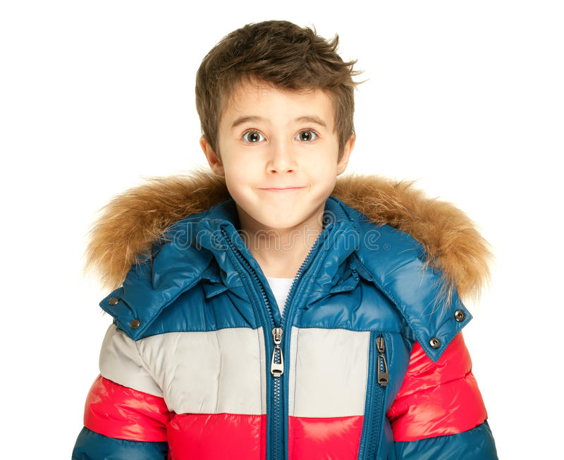 Little boy portrait in winter jacket isolated on white stock photography