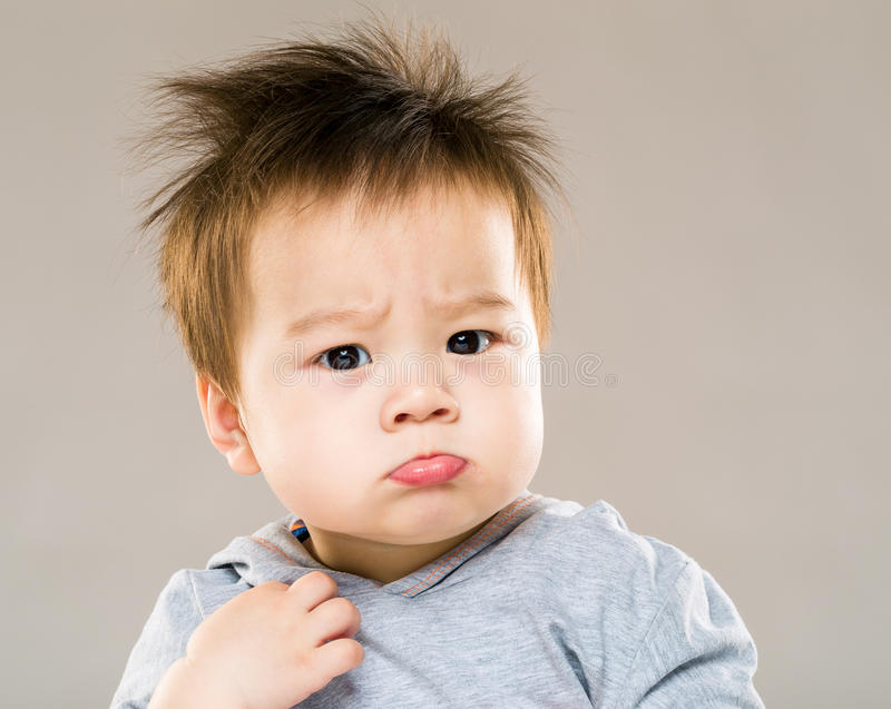 Little boy pouting royalty free stock photos