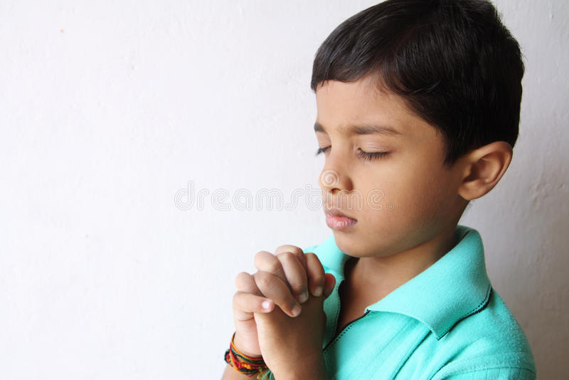 Little Boy Praying royalty free stock photos