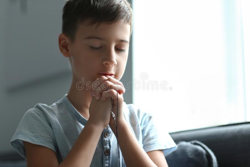 Little boy praying at home royalty free stock photos