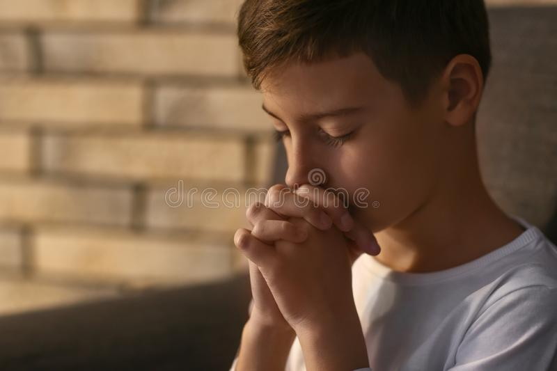Little boy praying at home stock photography