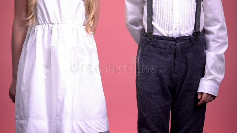 Little boy preparing to take hand cute girl close-up, first love, Valentines day royalty free stock images