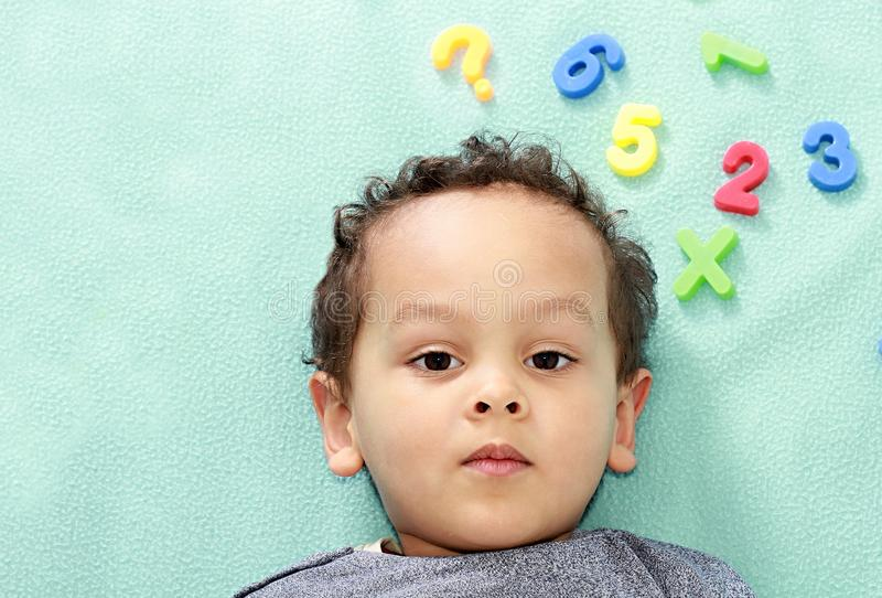 Little boy at preschool learning numbers stock photo stock photo