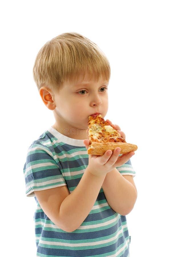 Little Boy que come a pizza imagem de stock royalty free