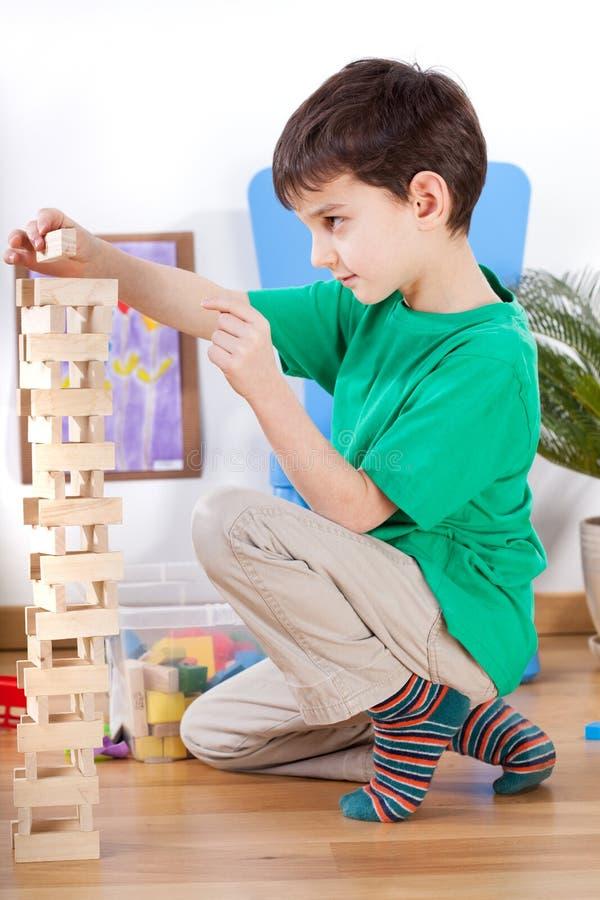 Little Boy que joga com brinquedos imagem de stock royalty free