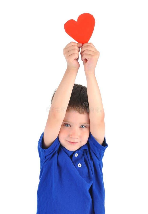 Little Boy que prende o coração do amor foto de stock royalty free
