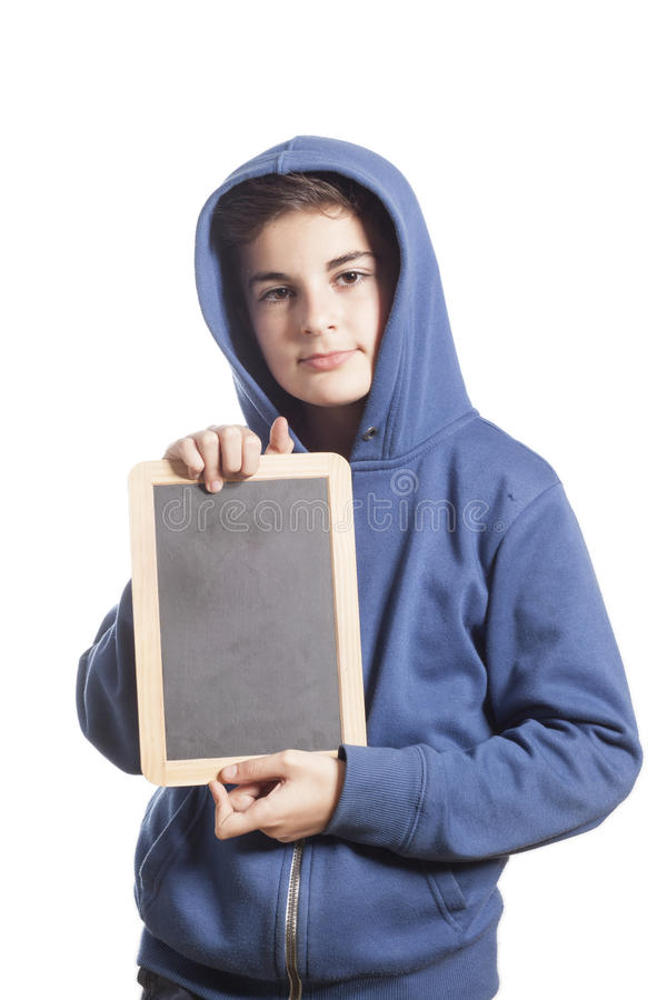 Little Boy que sostiene la pizarra en blanco foto de archivo