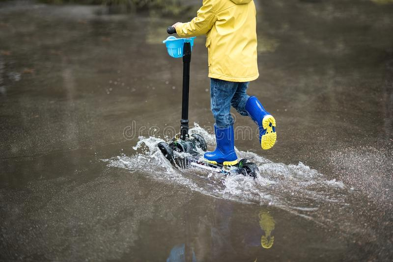 Little boy playing in puddle royalty free stock images