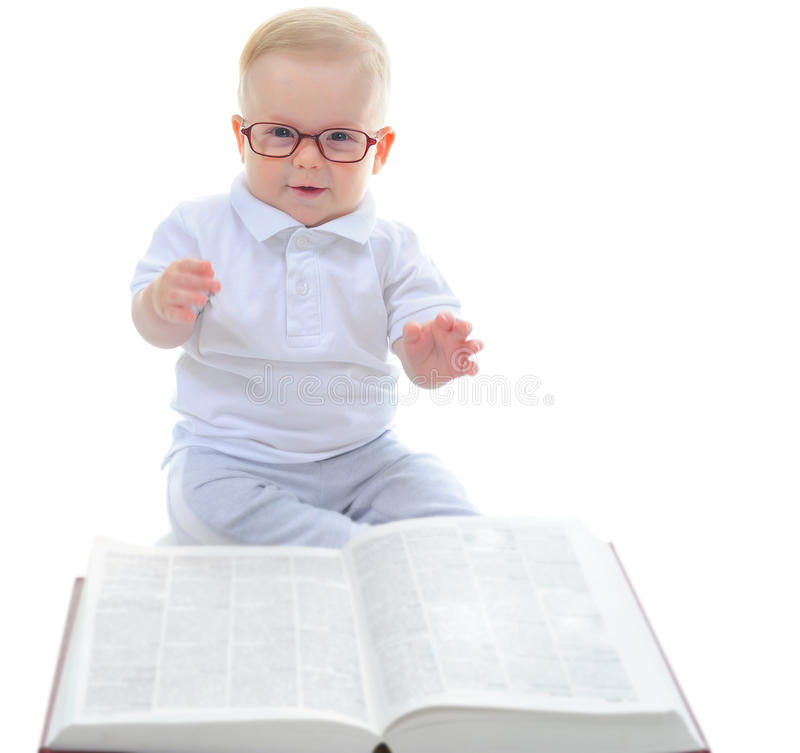 Little boy reads a big book royalty free stock images