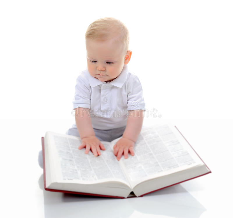 Little boy reads a big book royalty free stock image