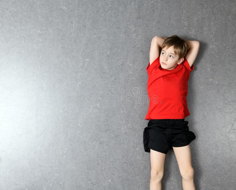 Little Boy In Red Shirt Lying On The Floor Stock Image ...
