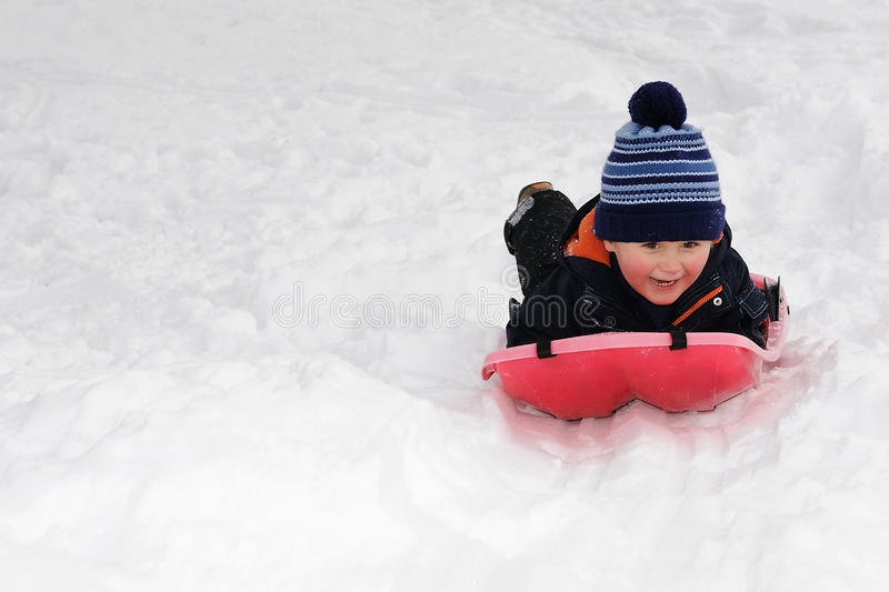 Download Little Boy On Red Sled Royalty Free Stock Images - Image: 23211479