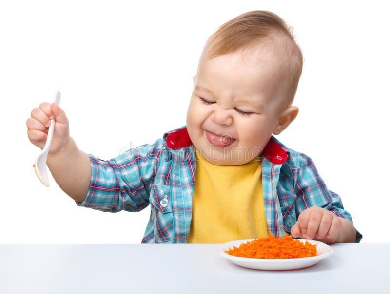 Little boy refuses to eat. Making unpleasant grimace, isolated over white stock image