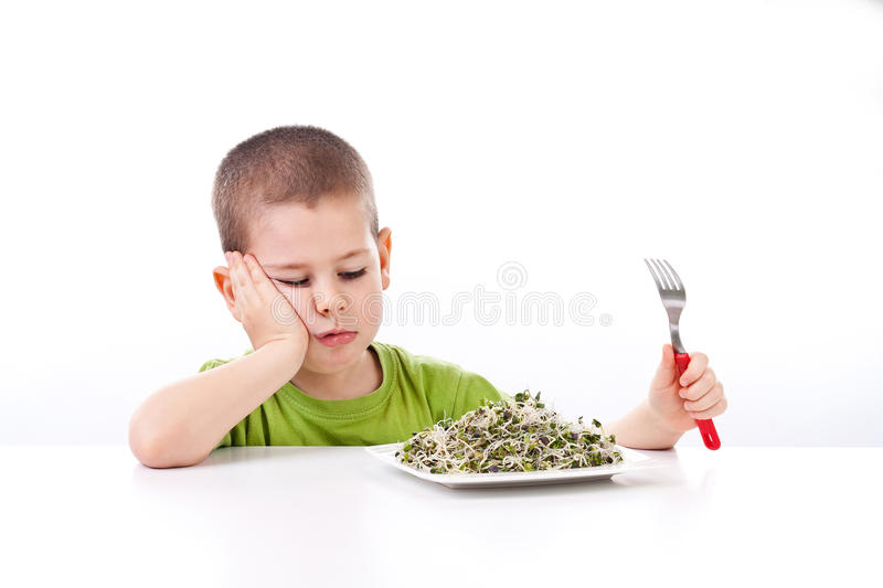 Little boy refuses to eating. Boy refuses to eating healthy food, isolated on white stock photo
