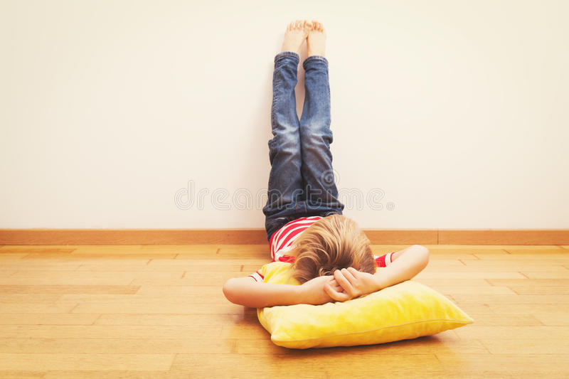 Little boy relax at home. Home laziness and comfort royalty free stock photo