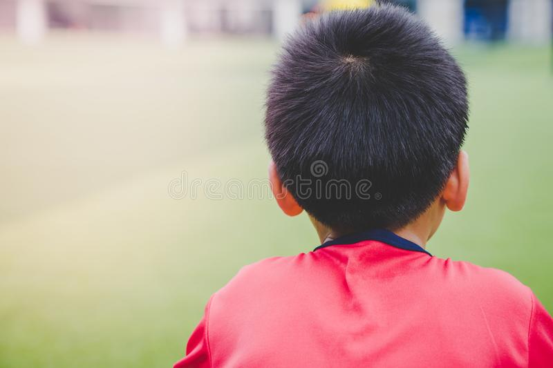 Little boy relaxing in soccer training field royalty free stock images