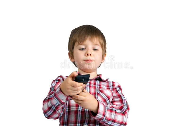 Little Boy With a Remote Control He Is Focusing On Which Button stock photo