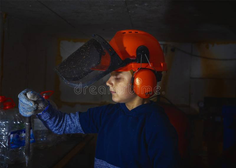 Little boy repairs water boilers in basement stock image