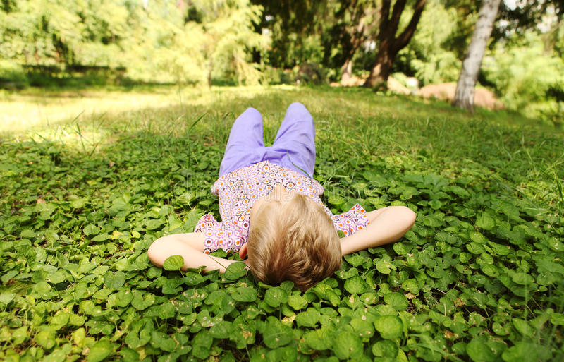 Download Little Boy Rest On The Green Park Meadow Stock Image - Image: 28547195