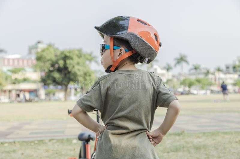 Little boy riding a bike. Child on bicycle. royalty free stock image