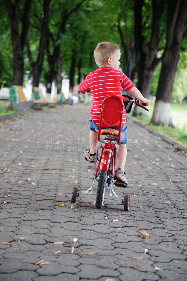 Download Little Boy Riding A Bike In Park Stock Photo - Image: 26033034