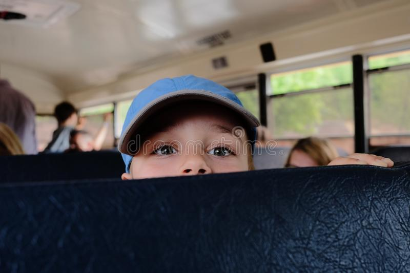 A little boy is riding a bus royalty free stock photo
