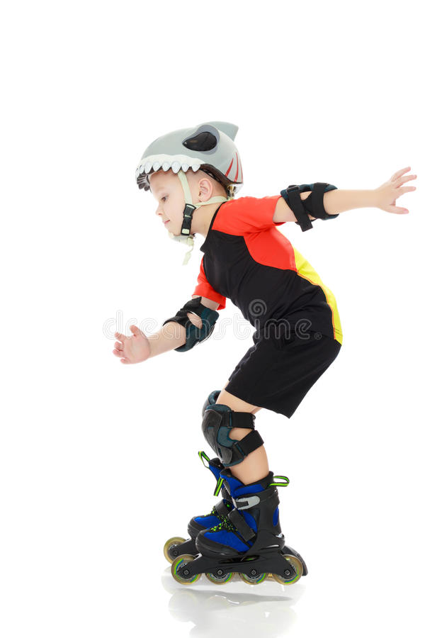 Little boy riding on the rollers. stock photos