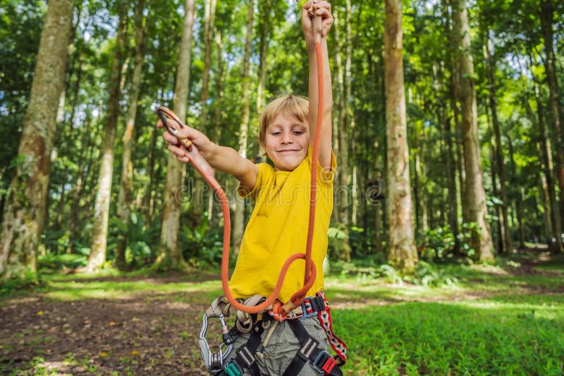 Little boy in a rope park. Active physical recreation of the child in the fresh air in the park. Training for children royalty free stock photos