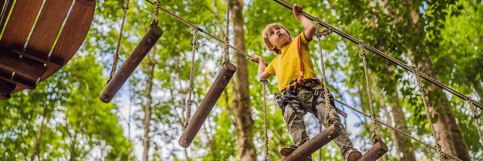 Little boy in a rope park. Active physical recreation of the child in the fresh air in the park. Training for children royalty free stock images